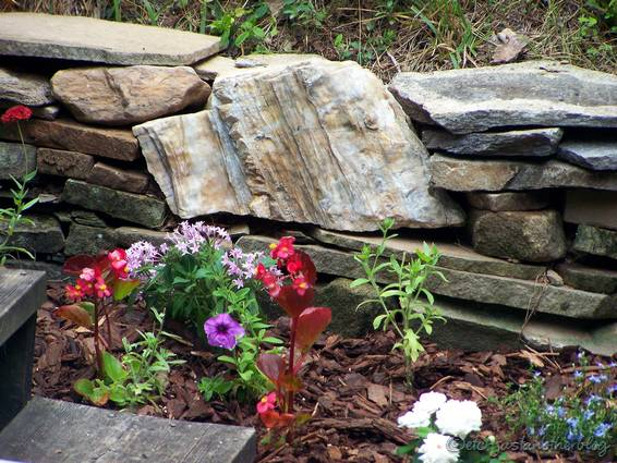 Rocks In Flower Beds Rock wall bed