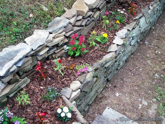 new rock wall flower bed sherry 39 s place. Black Bedroom Furniture Sets. Home Design Ideas