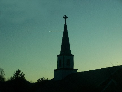church steeple and jet