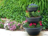 3-tiered planter at edge of dianthus bed