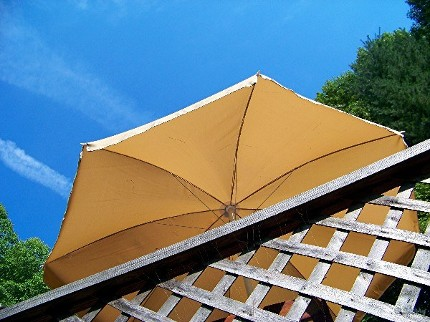 blue sky and yellow umbrella