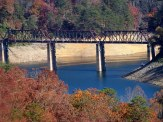 trestle and fisherman on the lake