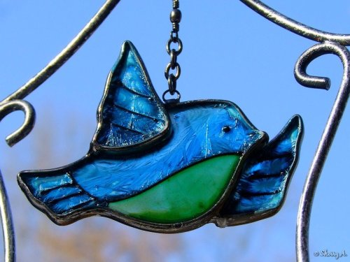 glass bird chime and blue sky