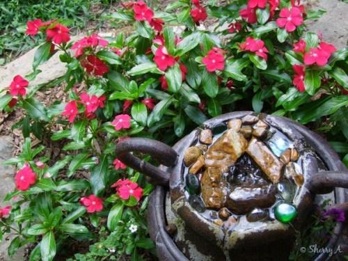 vinca surrounding fountain at gazebo