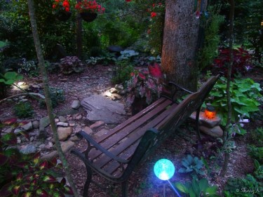 entrance to secret garden just after solar lights come on