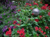 angelonia and pentas in lamp post flower bed