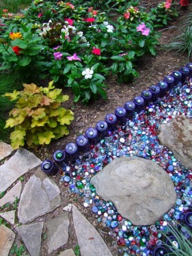 mexican feather grass and zinnias with colored glass path